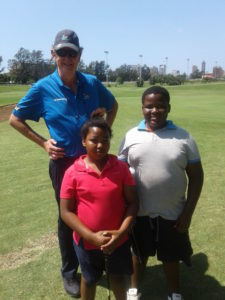 Ayanda and Tuffa getting their hole in one prizes from Neil